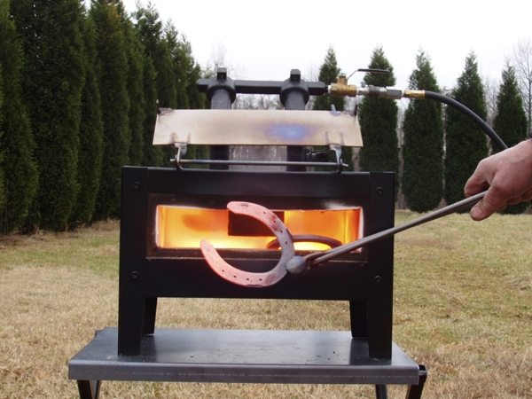 nc whisper deluxe forge with back door